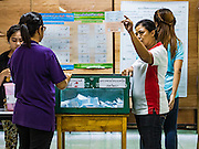 07 AUGUST 2016 - BANGKOK, THAILAND: Elections workers count the votes in the charter referendum in a polling place in Bangkok. Thais voted Sunday in the referendum to approve a new charter (constitution) for Thailand. The new charter was written by a government appointed panel after the military coup that deposed the elected civilian government in May, 2014. The charter referendum is the first country wide election since the coup. Elections workers counted the votes in the polling places after the polls closed at 16.00.      PHOTO BY JACK KURTZ