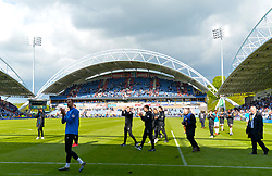 Huddersfield Town players applaud the fans after the final whistle of the Premier League match at the John Smith's Stadium, Huddersfield.