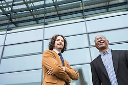 Businessmen meeting African modern architecture