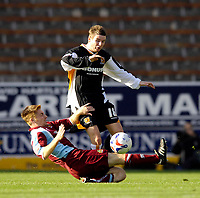 Photo: Jed Wee.<br />Burnley v Hull. Coca Cola Championship. 14/10/2006.<br /><br />Hull's Mark Yeates (R) is tackled by Burnley's James O'Connor.
