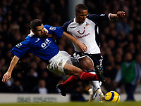 Photo: Daniel Hambury.<br />Tottenham Hotspur v Portsmouth. The Barclays Premiership. 12/12/2005.<br />Tottenham's Wayne Routledge battles with Portsmouth's Brian Piske.