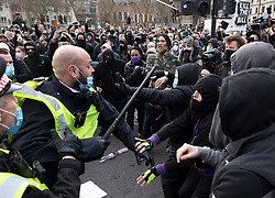 © Licensed to London News Pictures. 03/04/2021. London, UK. Police draw their batons as they come under attack as scuffles break out in Parliament Square during a Kill the Bill demonstration in central London. A coalition of groups including Extinction Rebellion, Kill the Bill & Black Lives Matter are coming together over the Easter weekend to campaign against the proposed Police, Crime, Sentencing and Courts Bill which will give police in England and Wales more power to impose conditions on non-violent protests. Photo credit: Peter Macdiarmid/LNP