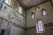 Stained glass windows and fresco artworks inside the Stadtkirche (City Church) in Stein am Rhein village, in Schaffhausen Canton, Switzerland, Europe.