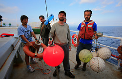 ITALY GIARDINI NAXOS 7MAY08 - Greenpeace campaigners display fishing gear confiscated after the pursuit of illegal driftnet fishing boat Diomede II to their home port of Giardini Naxos  in Sicily in the Mediterranean Sea...jre/Photo by Jiri Rezac / Greenpeace..© Jiri Rezac 2008..Contact: +44 (0) 7050 110 417.Mobile:  +44 (0) 7801 337 683.Office:  +44 (0) 20 8968 9635..Email:   jiri@jirirezac.com.Web:    www.jirirezac.com..© All images Jiri Rezac 2008 - All rights reserved.