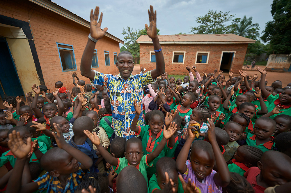 Victor Hume, a graduate of the Solidarity Teacher Training College (STTC) in Yambio, South Sudan, sings a song with his students in the Catholic Church-sponsored Abangite Nursery School in Yambio. The STTC is run by Solidarity with South Sudan, an international network of Catholic groups working to train teachers, health workers and pastoral agents throughout the African country.