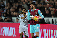 Carl Jenkinson of West Ham Utd ® keeps the ball away from Neil Taylor of Swansea city. . Barclays Premier league match, Swansea city v West Ham Utd at the Liberty Stadium in Swansea, South Wales  on Sunday 20th December 2015.<br /> pic by  Andrew Orchard, Andrew Orchard sports photography.