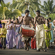 Local musician accompany the grrom and his entourage on their way to the wedding venue. Kerala 2007