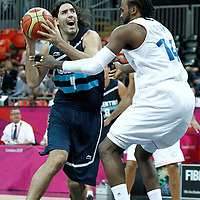 31 July 2012: Argentina Luis Scola goes to the basket against Ronny Turiaf of France during 71-64 Team France victory over Team Argentina, during the men's basketball preliminary, at the Basketball Arena, in London, Great Britain.