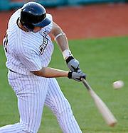 Gordon Gronkowski drives in the Crushers first run with an RBI-single scoring Jodem Rivera in the first inning. DAVID RICHARD / CHRONICLE
