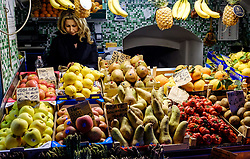 A lady sits behind her fruit stall in the Via Pescherie Vecchie, Bologna, Italy<br /> <br /> (c) Andrew Wilson | Edinburgh Elite media