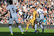 Dele Alli of Tottenham Hotspur © passes under pressure from Darren Fletcher of West Brom. Premier league match, West Bromwich Albion v Tottenham Hotspur at the Hawthorns stadium in West Bromwich, Midlands on Saturday 15th October 2016. pic by Andrew Orchard, Andrew Orchard sports photography.