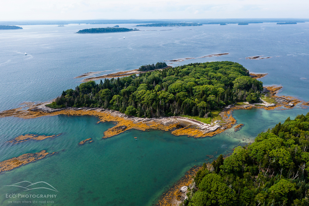 An aerial view of kayakers paddling around Little Whaleboat Island in Maine's Casco Bay.
