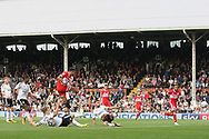 Cyrus Christie of Middlesbrough (3L) shoots and scores his team's first goal. EFL Skybet championship match, Fulham v Middlesbrough at Craven Cottage in London on Saturday 23rd September 2017<br /> pic by Steffan Bowen, Andrew Orchard sports photography.