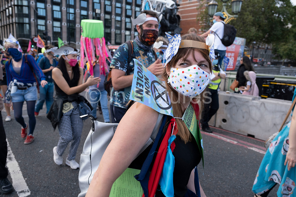 Extinction Rebellion activists dancing at the Marine Rebellion march on 6th September 2020 in London, United Kingdom. Ocean Rebellion, Sea Life Extinction, Animal Rebellion and Extinction Rebellion joined together to celebrate the biodiversity found in our seas, and to grieve at the destruction of the Earth's oceans and marine life due to climate breakdown and human interference, and the loss of lives, homes and livelihoods from rising sea levels. Extinction Rebellion is a climate change group started in 2018 and has gained a huge following of people committed to peaceful protests. These protests are highlighting that the government is not doing enough to avoid catastrophic climate change and to demand the government take radical action to save the planet.
