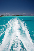 Wake of a boat traveling from the Bora Bora airport on Motu Mute to a resort on Motu Toopua, across the Bora Bora lagoon. Bora Bora is one of the Leeward Islands in the Society Islands archipelago of French Polynesia.