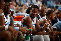 CHAPEL HILL, NC - FEBRUARY 05: Kenny Williams #24 of the North Carolina Tar Heels smiles from the bench during a game against the North Carolina State Wolfpack on February 05, 2019 at the Dean Smith Center in Chapel Hill, North Carolina. North Carolina won 113-96. North Carolina wore retro uniforms to honor the 50th anniversary of the 1967-69 team. (Photo by Peyton Williams/UNC/Getty Images) *** Local Caption *** Kenny Williams