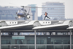 ALTERNATE CROP. A stunt double runs along Blackfriars Bridge in London, during filming for Mission Impossible 6.