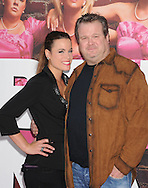 """WESTWOOD, CA - APRIL 28: Katherine Tokarz and Eric Stonestreet arrive at the premiere of Universal Pictures' """"Bridesmaids"""" held at Mann Village Theatre on April 28, 2011 in Los Angeles, California."""
