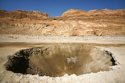 Israel, Dead Sea A sinkhole caused by the receding water level of the Dead Sea