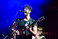 © Licensed to London News Pictures. 06/09/2014. Isle of Wight, UK. Foals performing live at Bestival 2014 Day 3 Saturday. In this picture Yannis Philippakis.  Foals are an English indie rock band from consisting of members Yannis Philippakis (lead vocals, lead guitar,drums), Jack Bevan (drums), Jimmy Smith (rhythm guitar), Walter Gervers (bass), Edwin Congreave (keyboards).  This weekend's headliners include Chic featuring Nile Rodgers, Foals and Outcast.   Bestival is a four-day music festival held at the Robin Hill country park on the Isle of Wight, England. It has been held annually in late summer since 2004.    Photo credit : Richard Isaac/LNP