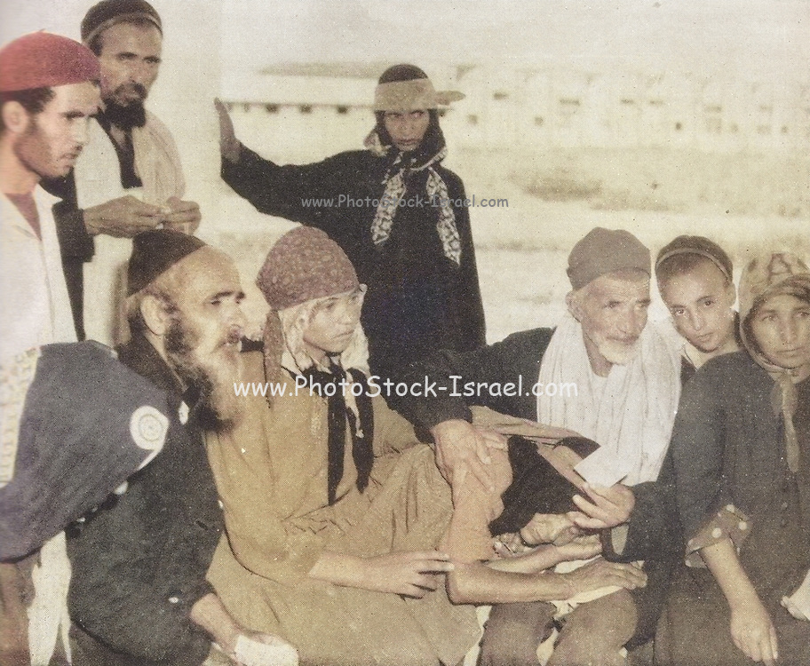 Machine colorized (AI) Yemenite Jews or Yemeni Jews,  arrive in Israel in 1949. They were brought out of Yemen by the new state of Israel to give them a secure and safe homeland. Between June 1949 and September 1950, the overwhelming majority of Yemen's Jewish population was transported to Israel in Operation Magic Carpet. After several waves of persecution throughout Yemen, most Yemenite Jews now live in Israel