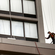 High-rise window washing of the Crown Plaza Hotel building exterior in downtown Kansas City, Missouri.