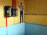 Picture of a law enforcement officer on a wall in Kota Kinabalu, Malaysia, Southeast Asia