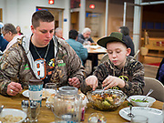 "26 FEBRUARY 2020 - FARMINGTON, MINNESOTA: ASHLEY FOLVEN and her nephew, JACOB FOLVEN eat their dinners at the community dinner at Faith Church, a United Methodist Church in Farmington, MN, about 30 minutes south of the Twin Cities. The dinner is sponsored by Loaves & Fishes, a Christian organization that provides food for community dinners and foodbanks. Farmington, with a population of 21,000, is a farming community that has become a Twin Cities suburb. The city lost its only grocery store, a Family Fresh Market, in December, 2019. The closing turned the town into a ""food desert."" In January, Faith Church started serving the weekly meals as a response to the store's closing. About 125 people per week attend the meal at the church, which is just a few blocks from the closed grocery store. The USDA defines food deserts as having at least 33% or 500 people of a census tract's population in an urban area living 1 mile from a large grocery store or supermarket. Grocery chains Hy-Vee and Aldi both own land in Farmington but they have not said when they plan to build or open stores in the town.      PHOTO BY JACK KURTZ"