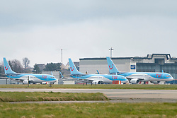 Glasgow, Scotland, UK. 25 March, 2020. Day two of the Government enforced lockdown in the UK. All shops and restaurants and most workplaces remain closed. Cities are very quiet with vast majority of population staying indoors. Pictured; Tui passenger aircraft remain grounded and parked at Glasgow Airport. Iain Masterton/Alamy Live News