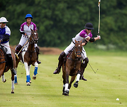 The Duke of Cambridge (right) takes part in the Jerudong Park Polo Day at Cirencester Park Polo Club, Cirencester.