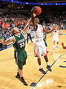 Nov. 15, 2010; Charlottesville, VA, USA; Virginia Cavaliers guard K.T. Harrell (24) reaches for a rebound with USC Upstate Spartans guard Carter Cook (33) during the game at the John Paul Jones Arena. Virginia won 74-54. Mandatory Credit: Andrew Shurtleff