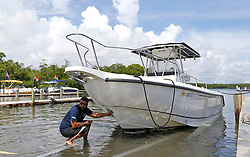 Haulover Marine Center employee Rayden Marquez pulls out one of the many boats from the Haulover Marine Center on Wednesday, September 6, 2017 in Miami Beach, FL, USA. as they prepare for Hurricane Irma. Photo by David Santiago/Miami Herald/TNS/ABACAPRESS.COM