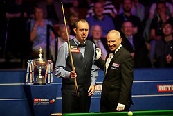 Referee Brendan Moore shares a joke with Mark Williams on day seventeen of the 2018 Betfred World Championship at The Crucible, Sheffield.