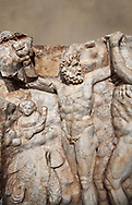 Detail of a Roman Sebasteion relief sculpture of Zeus and Prometheus, Aphrodisias Museum, Aphrodisias, Turkey.   Against an art background.<br /> <br /> Prometheus is screaming in pain. Zeus had given him a terrible punishment for giving fire to man: he was tied to the Caucasus mountains and had his liver picked out daily by an eagle. Herakles shot the eagle and is undoing the first manacle. He wears his trade mark lion-skin and thrown his club to one side. A small mountain nymph, holding a throwing stick appears amongst the rocks. .<br /> <br /> If you prefer to buy from our ALAMY STOCK LIBRARY page at https://www.alamy.com/portfolio/paul-williams-funkystock/greco-roman-sculptures.html . Type -    Aphrodisias     - into LOWER SEARCH WITHIN GALLERY box - Refine search by adding a subject, place, background colour, museum etc.<br /> <br /> Visit our ROMAN WORLD PHOTO COLLECTIONS for more photos to download or buy as wall art prints https://funkystock.photoshelter.com/gallery-collection/The-Romans-Art-Artefacts-Antiquities-Historic-Sites-Pictures-Images/C0000r2uLJJo9_s0
