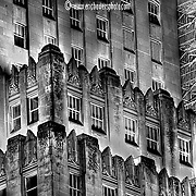A noir looking B&W shot of the old art-deco skyscraper, the Power and Light Building in downtown Kansas City.