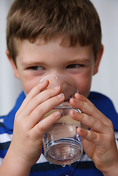 Child drinking tap water