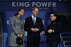 The Duke and Duchess of Cambridge speak with Aiyawatt Srivaddhanaprabha as they view the pitch from the stands at Leicester City Football ClubÕs King Power Stadium, during a visit to Leicester to pay tribute to those who were killed in the helicopter crash last month.