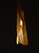 Golden illumination in twilight zone of Canyon Caves, Cathedral Gorge State Park, Nevada.