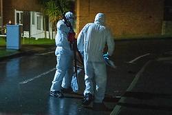 © Licensed to London News Pictures. 06/02/2021. Reading, UK. Forensic investigators carry lighting equipment inside the cordon in Tilehurst. At approximately 18:55GMT Thames Valley Police were called to reports of an altercation in Dulnan Close, Tilehurst in Reading. A 25-year-old man sustained multiple injuries and died at the scene. Photo credit: Peter Manning/LNP