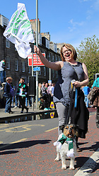 Hibernian Scottish Cup Open Top Bus Edinburgh 14 May 2016; A Hibs fan with her scarf wearing dog on Leith Walk during the open top bus parade in Edinburgh after winning the Scottish Cup.<br /> <br /> (c) Chris McCluskie | Edinburgh Elite media