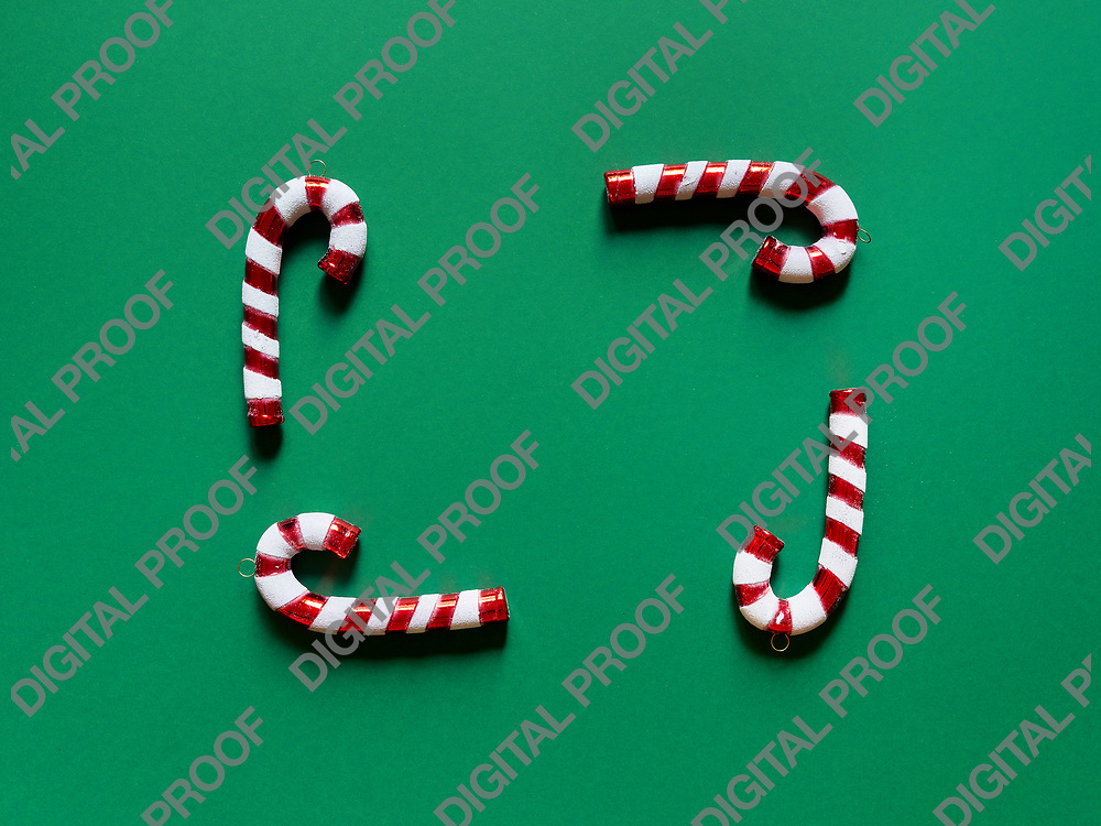 Christmas candy cane drums  at studio above view over a green background isolated flatlay