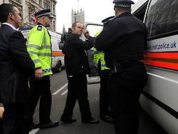 © Licensed to London News Pictures. 11/11/2011. London, UK. A man is put in a police van after being arrested. Police arrest members of the EDL near the Cenotaph following a Remembrance Day service today (11/11/2011). A large group of EDL members where arrested. Police a. Photo credit : Stephen Simpson/LNP