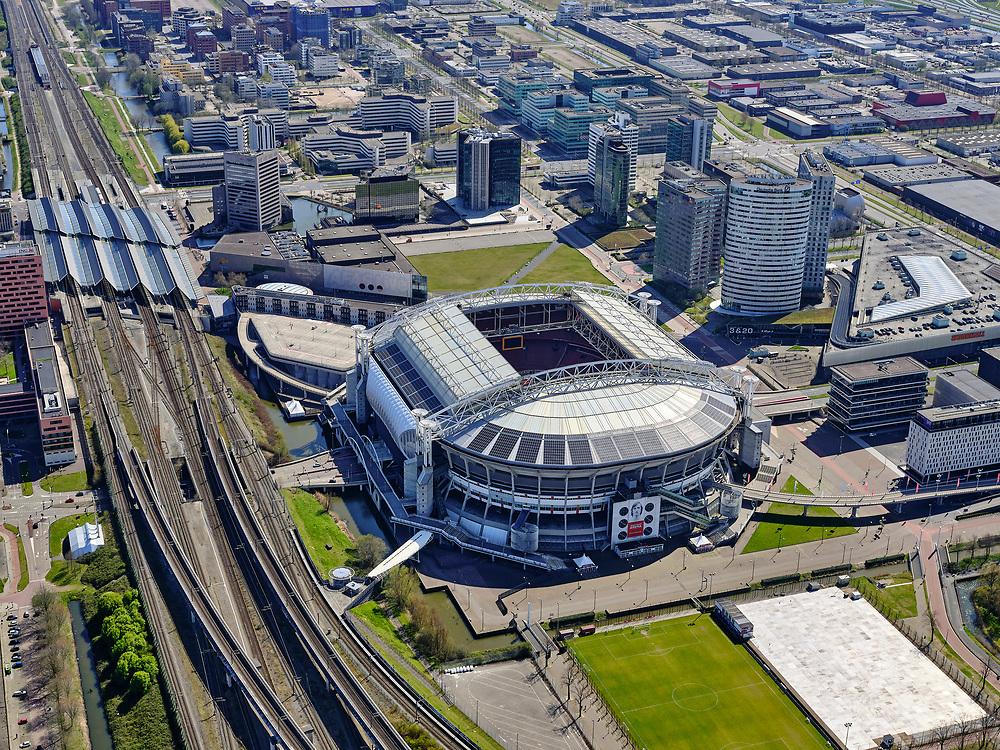 Nederland, Noord-Holland, Amsterdam; 17-04-2021; ArenA-gebied met Ajax stadion Arena, nu  Johan Cruijff Arena  (JohanCruijffArena). Links NS station Bijlmer Arena.<br /> ArenA area with Ajax stadium Arena, now Johan Cruijff Arena (JohanCruijffArena). Left Bijlmer Arena railway station.<br /> luchtfoto (toeslag op standaard tarieven);<br /> aerial photo (additional fee required)<br /> copyright © 2021 foto/photo Siebe Swart