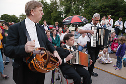 Group of musicians playing to accompany Morris dancers performance,