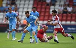 Coventry City's Toni Andreu battles with Stevenage's Joel Byrom