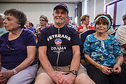 08 SEPTEMBER 2012 - SURPRISE, AZ:  A voter who supports Pres. Obama at a town hall meeting with Dr. Richard Carmona in Surprise, AZ. Carmona, a Democrat, is from Tucson, AZ. He is a former US Surgeon General, former Green Beret, and former SWAT Police officer, is running for the US Senate being vacated by Republican Sen. Jon Kyl. His opponent in the November election is Rep. Jeff Flake, a long serving Congressman from Mesa, a suburb of Phoenix.   PHOTO BY JACK KURTZ