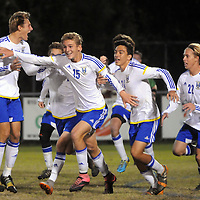 Laney's Tristan Nelson (15) celebrates with teammates after scoring the first and only goal of the game against New Hanover High School in the second overtime period at home. Laney beat New Hanover 1-0 to secure a spot in this Saturday's championship game in Raleigh. Mike Spencer/StarNews
