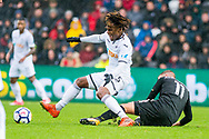 Renato Sanches of Swansea City falls over Marc Albrighton of Leicester City. Premier league match, Swansea city v Leicester city at the Liberty Stadium in Swansea, South Wales on Saturday 21st October 2017.<br /> pic by Aled Llywelyn, Andrew Orchard sports photography.
