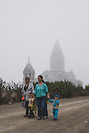 Shushi, Nagorno-Karabakh - September 23, 2016: On a misty afternoon, women and children walk past the Holy Savior Cathedral, or Ghazanchetsots Cathedral, in Shushi (Shusha), in the disputed region of Nagorno-Karabakh. Built in the 1880s, it is the seat of the Diocese of Artsakh of the Armenian Apostolic Church.