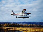 Michael W. Branham's de Havilland turboprop beaver on floats taking off from lake east of Beluga Mountain, Alaska.